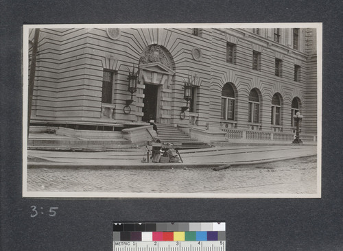 The San Francisco New Post Office, South East corner. Around this vicinity there were great seismic disturbances and the streets here settled and faulted but the Post Office being built on a pile foundation was not badly injured as the foundation if it moved at all all moved as a unit