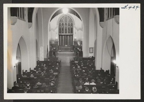 Beneath the high vaulted ceiling of the First Baptist Church of Chicago, the congregation listens to the first sermon by