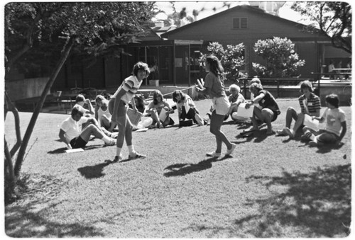 Students meeting on lawn on Matthews Campus