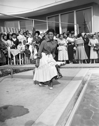 Woman at Pool grand opening, Los Angeles