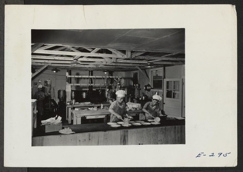 The kitchen section at work preparing dinner for Block 7, in the early afternoon. Photographer: Parker, Tom Denson, Arkansas