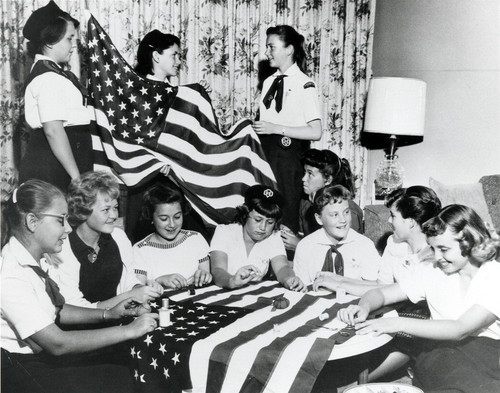 Girl Scouts prepare new 50-star flags for the City Council