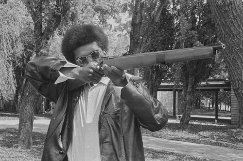 Black Panther with his gun, Marin City, CA, #52 from A Photographic Essay on The Black Panthers