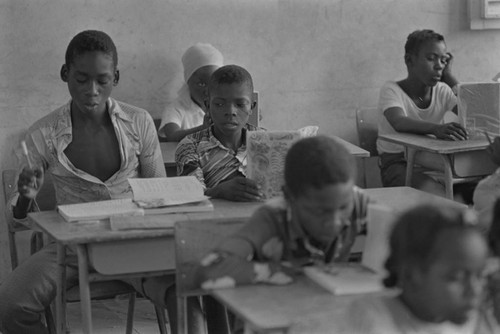 Students in a classroom working, San Basilio de Palenque, ca. 1978