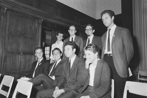 Eight students suspended on Sept 30th for operating a table on campus without a permit, and raising money for unauthorized purposes. Left to right. Seated: Brian Turner, Sandor Fuchs, Arthur Goldberg, Elizabeth Gardner. Standing: David Lance Goines, Mark Bravo, Don Hatch, Mario Savio