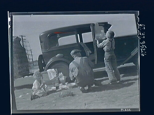 Untitled (Family Eating by Car)