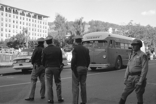 Alameda County sheriff's department bus and policemen on Bancroft Way