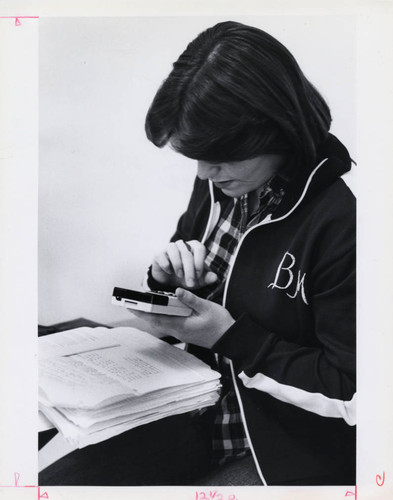 A student using a calculator, Claremont McKenna College