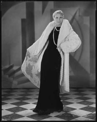 Calisphere: Peggy Hamilton modeling a white ermine coat over a black ...