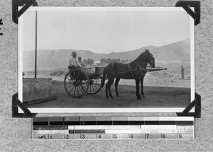 Two missionary workers in a horse-drawn cart, South Africa, 1930