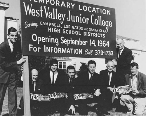 Temporary location sign for West Valley Junior College at Campbell Grammar School location, 1964, with Board members and administrators