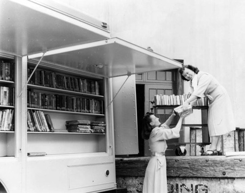 Replenishing the shelves of an LAPL Traveling Branch Bookmobile