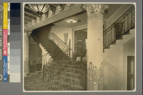 [Interior, unidentified building. With iron railing on staircase.]