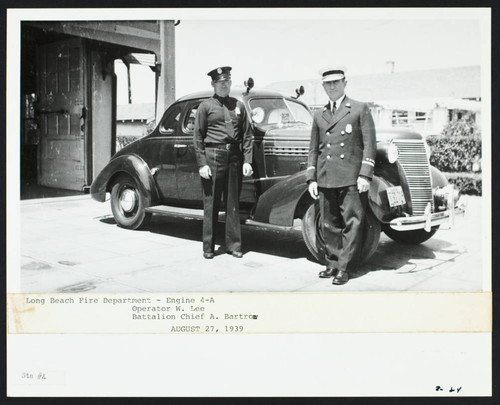 Operator W. Lee and Battalion Chief A. Bartron in front of Station No. 4, 4th and Loma