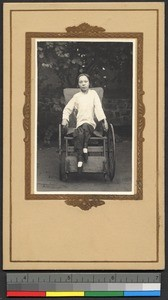 Young woman in wheelchair, China, 1932