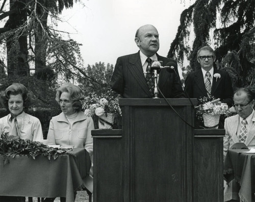M. Norvel Young speaking at foster grandparents ceremony, 1975