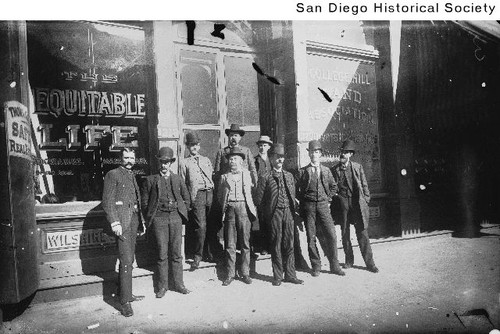 Employees of the Equitable Life Insurance Company standing outside their office at 1318 D Street