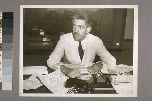 Sidney [Coe] Howard at his desk in Playwrights' office — Calisphere