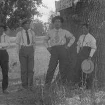 Exterior view of four men in front of Fair Oaks Center