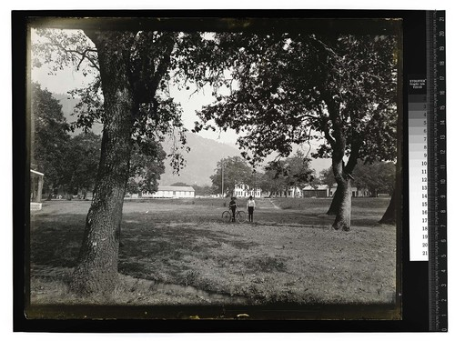 [Two young mena and a bicycle at Hoopa Valley Reservation]