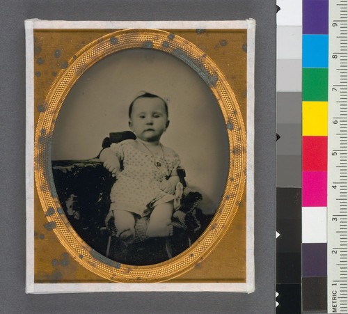 [Unidentified baby with a gold necklace.]