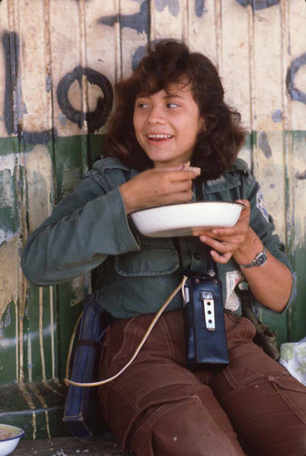 Woman guerrilla eating, San Agustín, 1983