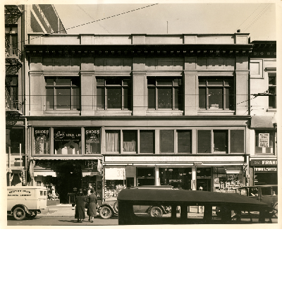 City Market building, east side of Washington Street between 12th and 13th Streets in downtown Oakland, California. Lewis Shoes, New City Market in view