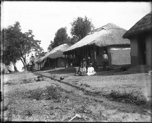 African people in front of buildings with thatched roofs, Shilouvane, South Africa