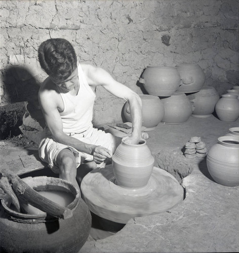 Potter at work with pottery wheel