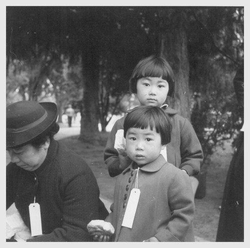 Hayward, Calif.--Two children of the Mochida family who, with their parents, are awaiting evacuation bus. The youngster on the right