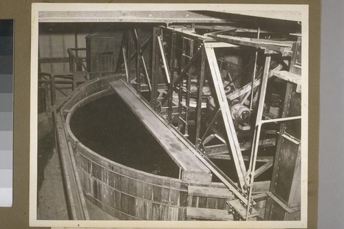 The pulp from the crushers is then transferred to these water filled vats. The wood pulp sinks to the bottom and the rubber and cork rises to the top and is skimmed off