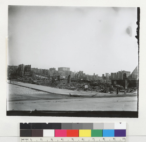 [View from Market St. (?) looking north to Nob Hill and Fairmont Hotel in distance.]