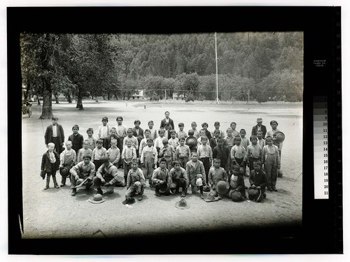 [Large group of boys and a few adults posing at the Hoopa Valley Reservation]