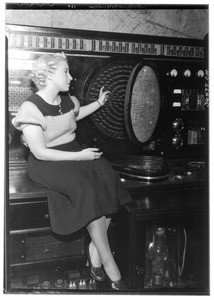 "Woman demonstrating the ""Spitz flight recorder"" at the United Airport in Burbank, July 1937"