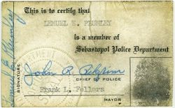 "Sebastopol Police Officer Lemual ""Shorty"" Plumley's ID card signed by Chief of Police John R. Pilgrim and Mayor Frank L. Fellers with Plumley's fingerprint"