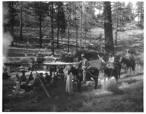 Hunting party returns on horseback to camp, ca.1900