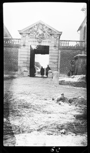 View of soldiers standing near a gateway in France during World War I, ca.1916