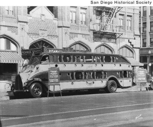 A double-decker bus parked in front of the Pickwick Hotel in downtown San Diego