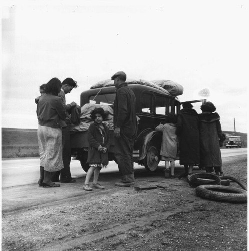 Migrant family of Mexicans on the road with car trouble, February, 1936