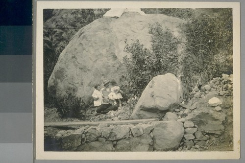 Outdoors at B [i.e. Bully] Hill. Jane is little girl. Girl on right: Elsie Jane May (sister of Prof. Henry May).]