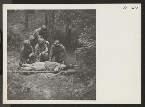 Captain Freyberger instructs a medical unit in the care of the wounded in the field. They are here shown placing