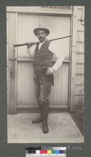 [Unidentified police officer posing with guns.]
