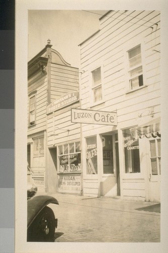 Snapshots of laborers and buildings, location unknown: Shows the Luzon Cafe