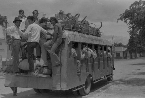 People riding the bus, La Chamba, Colombia, 1975