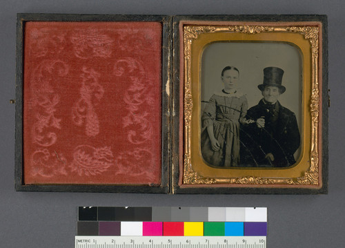 [Catherine Joeckel Schütt and Grandfather Joeckel in a top hat.]