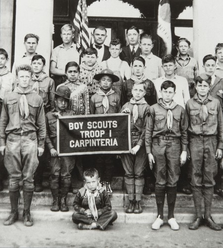 Carpinteria Boy Scout Troop with Kenji and Tom Ota in front of Carpinteria Union School : 1926. Kenji left of banner, Tom directly behind banner