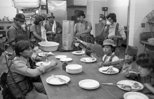 Sandinistas eat at a hotel, Managua, 1979