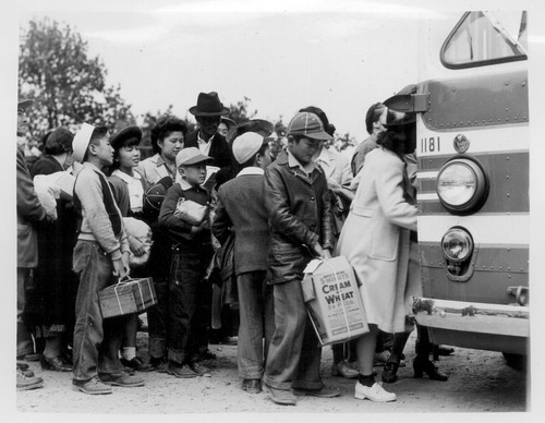 Members of farm families board evacuation buses. Evacuees of Japanese ancestry will be housed in War Relocation Authority centers for the duration. Photographer: Lange, Dorothea Centerville, California
