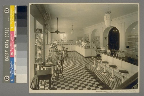 [Interior, unidentified restaurant, with candy display and soda fountain. Photograph by Alfred Greene.]
