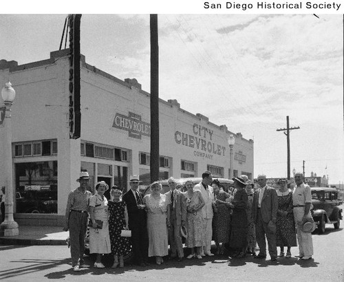Employees Of City Chevrolet Standing Outside The Dealership